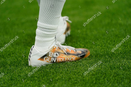 Denver Broncos wide receiver Diontae Spencer wears special cleats before an NFL football game between the Houston Texans and the Denver Broncos, in Houston