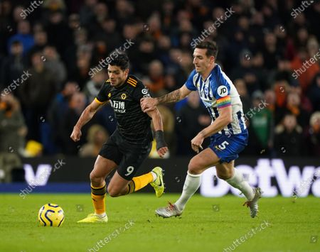 Raul Jimenez of Wolves and Lewis Dunk of Brighton.