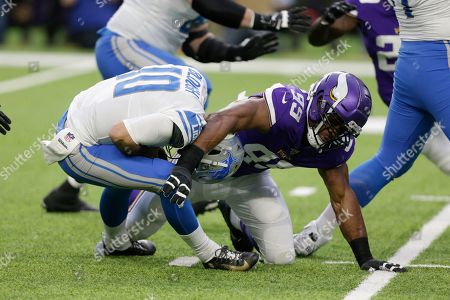 Detroit Lions quarterback David Blough (10) is sacked by Minnesota Vikings defensive end Danielle Hunter (99) during the first half of an NFL football game, in Minneapolis