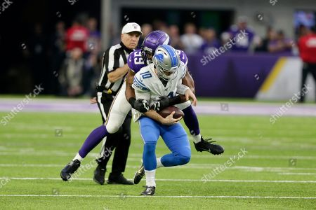 Detroit Lions quarterback David Blough is sacked by Minnesota Vikings defensive end Danielle Hunter (99) during the first half of an NFL football game, in Minneapolis