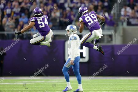 Minnesota Vikings' Eric Kendricks (54) and Danielle Hunter (99) celebrate after a missed field goal by Detroit Lions kicker Matt Prater, center, during the first half of an NFL football game, in Minneapolis