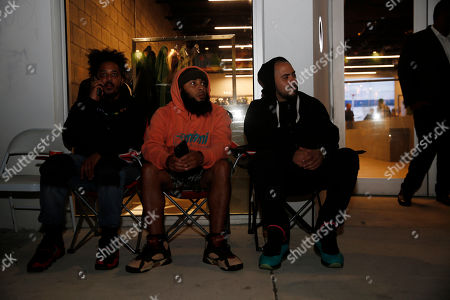 In this, Gabriel Gomez, right, waits first in line, since Sunday, at LeBron James' new retail spot UNKNWN for when new shoes dropped to the public Thursday morning, during Miami Art Week in Wynwood, a neighborhood in Miami