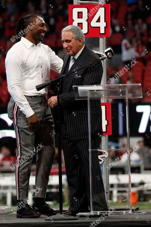 Former Atlanta Falcons player Roddey White participaits in his Ring of Honor ceremony with Atlanta Falcons owner Arthur Blank during an NFL football game between the Atlanta Falcons and the Carolina Panthers, in Atlanta