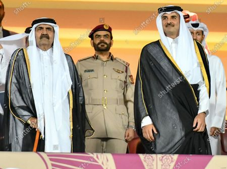 Qatar Emir Sheikh Tamim bin Hamad al-Thani (R) in the stands before the 24th Arabian Gulf Cup final soccer match between Bahrain and Saudi Arabia at the Abdullah bin Khalifa Stadium in Doha, Qatar, 08 December 2019.