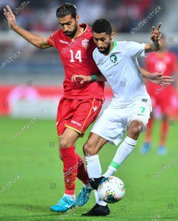 Ali Haram (L) of Bahrain in action against Salman Al-Faraj (R) of Saudi Arabia during the 24th Arabian Gulf Cup final soccer match between Bahrain and Saudi Arabia at the Abdullah bin Khalifa Stadium in Doha, Qatar, 08 December 2019.