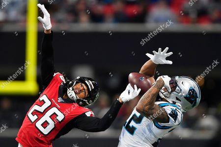Carolina Panthers wide receiver D.J. Moore (12) makes ther catch against Atlanta Falcons cornerback Isaiah Oliver (26) during the first half of an NFL football game, in Atlanta