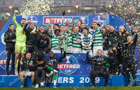 Celtic captain Scott Brown lifts the Betfred Cup with team mates on the winner's podium