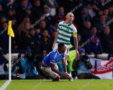 Stock Image of Celtic captain Scott Brown appears to kick Alfredo Morelos of Rangers