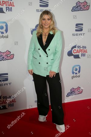 Ella Henderson poses for photographers upon arrival at Capital's 'Jingle Bell Ball', at the o2 arena