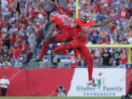 Tampa Bay Buccaneers cornerback Carlton Davis (33) and Tampa Bay Buccaneers cornerback Sean Murphy-Bunting (26) celebrate a defensive stop during the NFL game between the Indianapolis Colts and the Tampa Bay Buccaneers held at Raymond James Stadium in Tampa, Florida. Andrew J