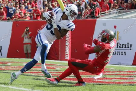Indianapolis Colts wide receiver Marcus Johnson (83) catches a touchdown pass in the first quarter as Tampa Bay Buccaneers safety Andrew Adams (39) defends during the NFL game between the Indianapolis Colts and the Tampa Bay Buccaneers held at Raymond James Stadium in Tampa, Florida. Andrew J