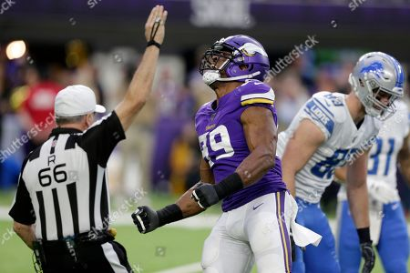 Minnesota Vikings defensive end Danielle Hunter (99) celebrates after sacking Detroit Lions quarterback David Blough during the first half of an NFL football game, in Minneapolis
