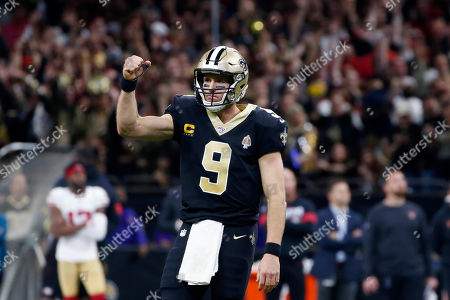 Stock Photo of New Orleans Saints quarterback Drew Brees (9) reacts after throwing a touchdown pass to Michael Thomas in the second half an NFL football game against the San Francisco 49ers in New Orleans
