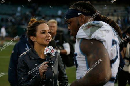 Stock Photo of Reporter Dianna Russini, left, interviews Tennessee Titans running back Derrick Henry after an NFL football game between the Oakland Raiders and the Titans in Oakland, Calif