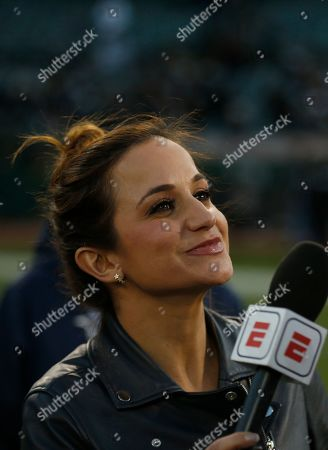 Reporter Dianna Russini interviews a player after an NFL football game between the Oakland Raiders and the Tennessee Titans in Oakland, Calif