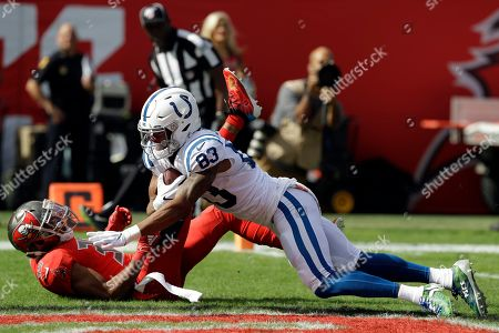 Indianapolis Colts wide receiver Marcus Johnson (83) beats Tampa Bay Buccaneers strong safety Andrew Adams (39) on a 46-yard touchdown reception during the first half of an NFL football game, in Tampa, Fla