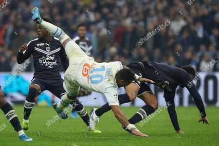 ONE. Marseille's Dimitri Payet falls after colliding with Bordeaux's Pablo during the French League One soccer match between Marseille and Bordeaux at the Velodrome stadium in Marseille, southern France