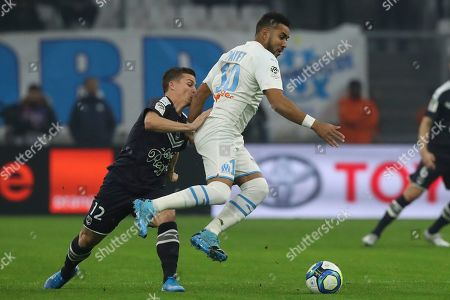 ONE. Bordeaux's Nicolas de Preville challenges Marseille's Dimitri Payet for the ball during the French League One soccer match between Marseille and Bordeaux at the Velodrome stadium in Marseille, southern France