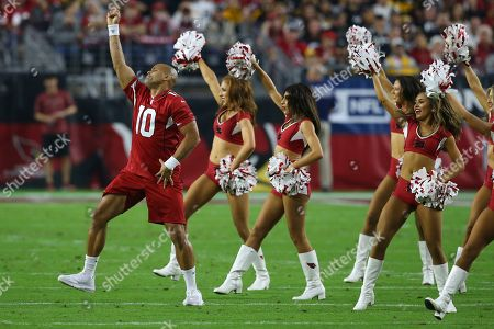 The Arizona Cardinals cheerleaders perform with fitness expert Shaun-T during the first half of an NFL football game against the Pittsburgh Steelers, in Glendale, Ariz