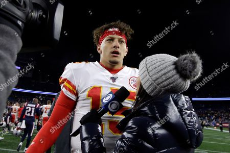 Stock Photo of CBS sideline sports broadcaster Tracy Wolfson, right, interviews Kansas City Chiefs quarterback Patrick Mahomes at midfield after an NFL football game between the Chiefs and the New England Patriots, in Foxborough, Mass