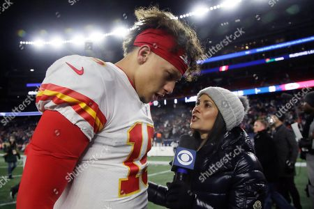 Stock Image of CBS sideline sports broadcaster Tracy Wolfson, right, interviews Kansas City Chiefs quarterback Patrick Mahomes at midfield after an NFL football game between the Chiefs and the New England Patriots, in Foxborough, Mass