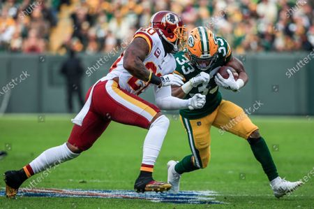 Washington Redskins strong safety Landon Collins (L) stops Green Bay Packers running back Aaron Jones (R) during the NFL game between the Washington Redskins and the Green Bay Packers at Lambeau Field in Green Bay, Wisconsin, USA, 08 December 2019.