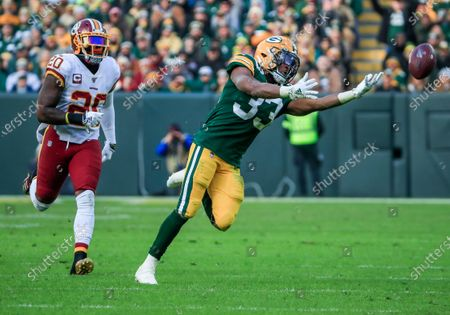 Green Bay Packers running back Aaron Jones (R) reaches for a pass that is beyond his reach as Washington Redskins strong safety Landon Collins (L) follows up to defend during the NFL game between the Washington Redskins and the Green Bay Packers at Lambeau Field in Green Bay, Wisconsin, USA, 08 December 2019. The Packers defeated the Redskins.