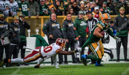 Stock Image of Washington Redskins strong safety Landon Collins (L) holds onto the shirt tail of Green Bay Packers tight end Jimmy Graham (R) during the NFL game between the Washington Redskins and the Green Bay Packers at Lambeau Field in Green Bay, Wisconsin, USA, 08 December 2019.