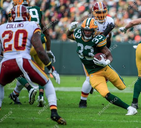Green Bay Packers running back Aaron Jones (R) cuts away from Washington Redskins strong safety Landon Collins (L) during the NFL game between the Washington Redskins and the Green Bay Packers at Lambeau Field in Green Bay, Wisconsin, USA, 08 December 2019.