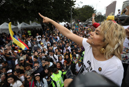 Colombian singer Adriala Lucia performs during a musical protest against the government of President Ivan Duque in Bogota, Colombia, . The performances coincide with recent demonstrations calling on Duque to throw out a proposed tax reform, improve conditions for threatened social leaders and fully implement Colombia's historic peace accord with leftist rebels