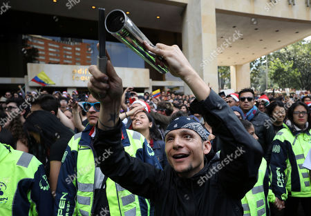 Lead singer Mario Munoz of the Colombian rock band Doctor Krapula, takes part in a musical protest against the government of President Ivan Duque in Bogota, Colombia, . The performances coincide with recent demonstrations calling on Duque to throw out a proposed tax reform, improve conditions for threatened social leaders and fully implement Colombia's historic peace accord with leftist rebels