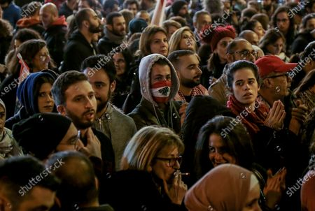 Protesters shout slogans against the parlianment members, during an anti-government protest in front of the Parliament building in Beirut, Lebanon, 08 December 2019. Protests in Lebanon are continuing since it first erupted on 17 October, as protesters aim to apply pressure on the country's political leaders to over what they view as a lack of progress following the prime minister's resignation on 29 October,  demand to speed up the process to appointment of a new prime minister, without the corrupt political class. Lebanese President Michel Aoun called for formal consultations on 09 December with lawmakers to designate a new prime minister, but it was canceled after the candidate Samir Khatib announced his withdrawal from the candidacy, after his visit Dar Al Fatwa, as said to media that, the country's top Sunni religious authority told him the community supports resigned prime minister Saad Hariri to take back the post.