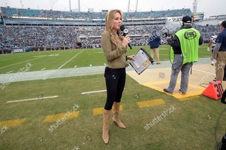 FOX Sports television sideline reporter Jennifer Hale broadcasts from the field before an NFL football game between the Jacksonville Jaguars and the Los Angeles Chargers, in Jacksonville, Fla