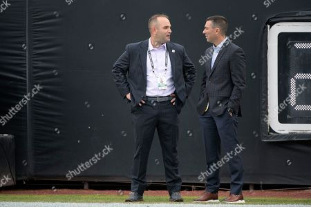 Stock Photo of Jacksonville Jaguars general manager David Caldwell, left, talks with Los Angeles Chargers general manager Tom Telesco on the field before an NFL football game, in Jacksonville, Fla