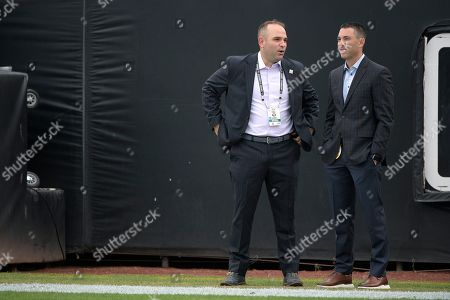 Stock Image of Jacksonville Jaguars general manager David Caldwell, left, talks with Los Angeles Chargers general manager Tom Telesco on the field before an NFL football game, in Jacksonville, Fla