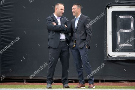 Stock Picture of Jacksonville Jaguars general manager David Caldwell, left, talks with Los Angeles Chargers general manager Tom Telesco on the field before an NFL football game, in Jacksonville, Fla