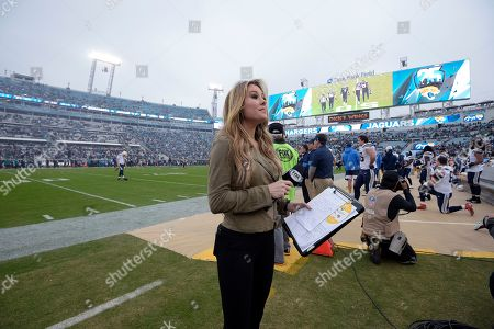 FOX Sports sideline reporter Jennifer Hale works from the field before an NFL football game between the Jacksonville Jaguars and the Los Angeles Chargers, in Jacksonville, Fla