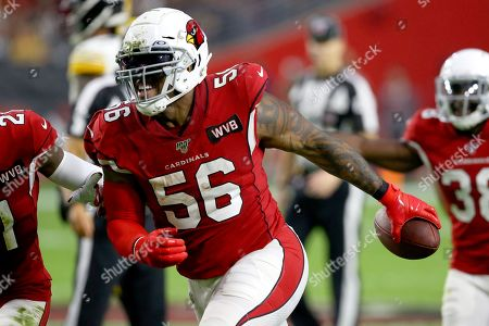 Arizona Cardinals outside linebacker Terrell Suggs (56) celebrates his fumble recovery against the Pittsburgh Steelers during the first half of an NFL football game, in Glendale, Ariz