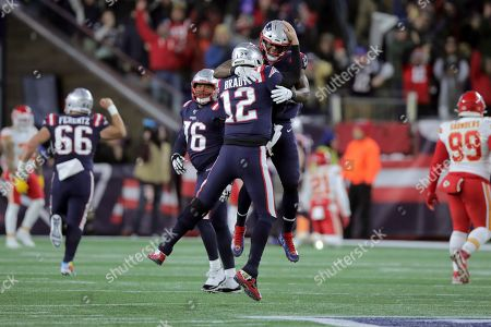 New England Patriots quarterback Tom Brady (12) celebrates his touchdown pass to Julian Edelman with tight end Benjamin Watson, rear, in the first half of an NFL football game against the Kansas City Chiefs, in Foxborough, Mass