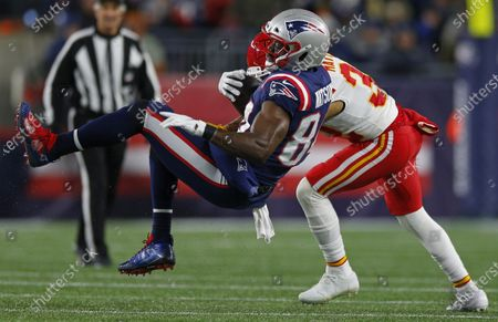 New England Patriots tight end Benjamin Watson (L) is tackled by Kansas City Chiefs running back Darwin Thompson (R) during the second half at Gillette Stadium in Foxborough, Massachusetts, USA, 08 December 2019.