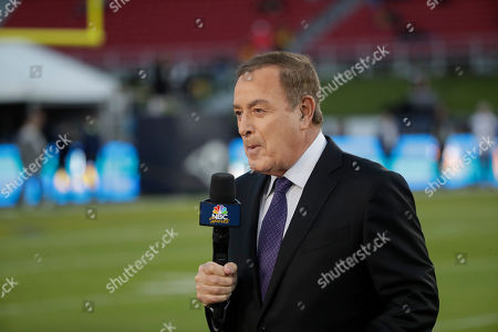 Al Michaels, play-by-play voice for NBC's Sunday Night Football works on the sideline before an NFL football game between the Los Angeles Rams and the Seattle Seahawks, in Los Angeles