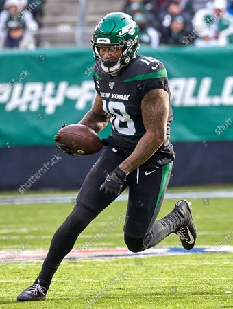 Stock Picture of , 2019, East Rutherford, New Jersey, USA: New York Jets wide receiver Demaryius Thomas (18) runs after a catch during a NFL game between the Miami Dolphins and the New York Jets at MetLife Stadium in East Rutherford, New Jersey. Jets defeated the Dolphins 22-21
