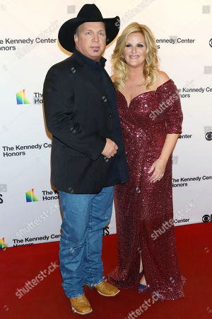 Garth Brooks, Trisha Yearwood. Garth Brooks, left, and Trisha Yearwood attend the 42nd Annual Kennedy Center Honors at The Kennedy Center, in Washington