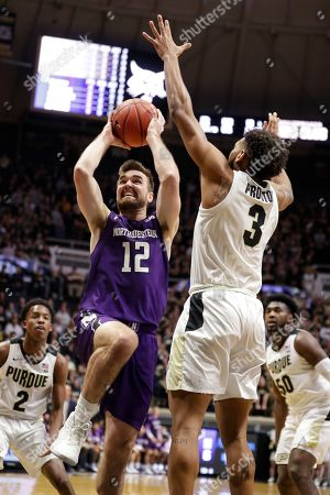 Northwestern guard Pat Spencer (12) shoots over Purdue guard Jahaad Proctor (3) during the first half of an NCAA college basketball game in West Lafayette, Ind