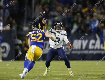 Seattle Seahawks quarterback Russell Wilson (3) throws a pass as Los Angeles Rams outside linebacker Clay Matthews (52) defends during the NFL game between the Los Angeles Rams and the Seattle Seahawks at the Los Angeles Memorial Coliseum in Los Angeles, California