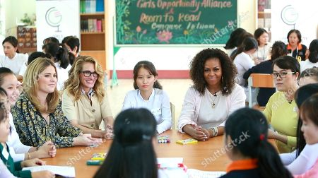 Michelle Obama, Julia Roberts, Jenna Bush Hager. Former U.S. fist lady Michelle Obama, actress Julia Roberts, fifth left, and Jenna Bush Hager, fourth left, talk with female students at the Can Giuoc high school in Long An province, Vietnam on . Mrs. Obama is on a trip to Vietnam to promote education for adolescent girls