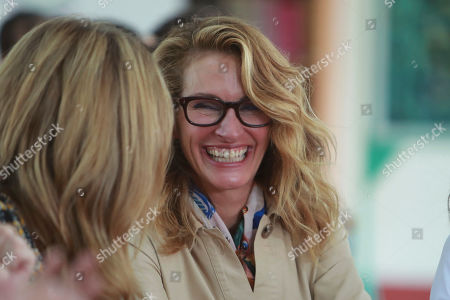 Actress Julia Roberts shares a laugh with Jenna Bush Hager as they meet with female students at Can Giuoc high school in Long An province, Vietnam . Roberts is accompanying U.S. former first lady Michelle Obama on a trip to Vietnam to promote education for adolescent girls