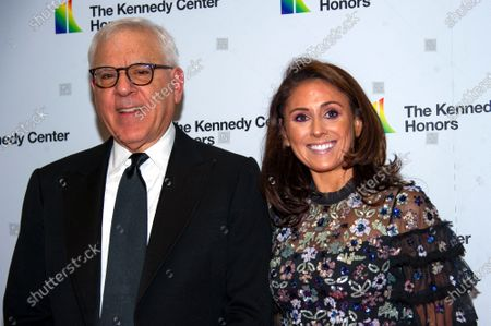 Kennedy Center Chairman David M. Rubenstein, (L), and daughter Ellie (R) arrive for the formal Artist's Dinner honoring the recipients of the 42nd Annual Kennedy Center Honors at the United States Department of State in Washington, DC, USA, 07  December 2019 (Issued 08 December 2019). The 2019 honorees are Earth, Wind & Fire, Sally Field, Linda Ronstadt, Sesame Street, and Michael Tilson Thomas.