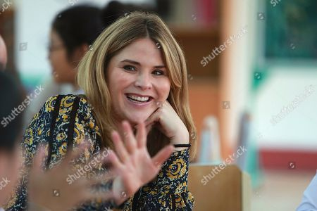 Jenna Bush Hager waves at students at Can Giuoc high school in Long An province, Vietnam . Bush Hager is accompanying U.S. former first lady Michelle Obama on a trip to Vietnam to promote education for adolescent girls