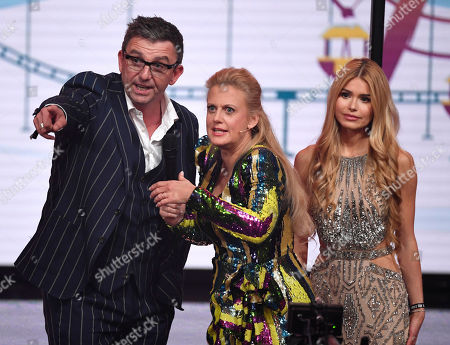 "Stock Picture of German influencer Pamela Reif, right, stands together with actor Hans Sigl, left, as presenter Barbara Schoeneberger, center, looks on during the charity gala ""Ein Herz fuer Kinder"" (a heart for children) in Berlin, Germany"